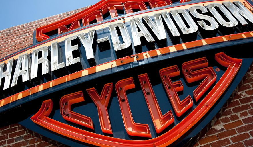 This Monday, July 16, 2012, photo, shows a sign for Harley-Davidson Motorcycles at the Harley-Davidson store in Glendale, Calif.  On Feb. 1, 2017, CNN reported that a planned visit by President Trump to a Harley plant in Milwaukee was canceled by the company due to concern over attracting protesters outside the facility. (AP Photo/Grant Hindsley, File)