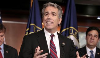 In this Nov. 15, 2011, file photo former Rep. Joe Walsh, R-Ill., gestures during a news conference on Capitol Hill in Washington. In an August 15, 2019, op-ed published at CNN.com, Mr. Walsh said he regretted having supported Donald Trump's 2016 campaign and called for a Republican to jump in to the primary race to challenge the president. (AP Photo/Carolyn Kaster, File) **FILE**