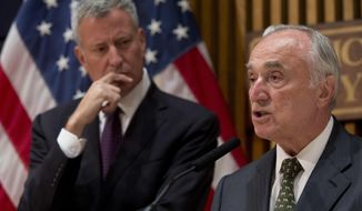 New York City Police Commissioner William Bratton is joined by Mayor Bill de Blasio during a news conference, Friday, July 8, 2016, in New York.  The NYPD is stepping up measures in the wake of the attack on Dallas police. Bratton said officers will double up on patrols for their safety and police presence will be increased at protests. They say there is no credible threat against the police force or the city, and the steps were being taken as a precaution. (AP Photo/Mary Altaffer)