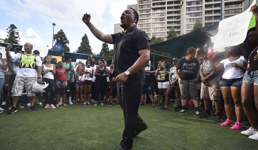 Francys Johnson state president of the Georgia NAACP chants in Centennial Olympic Park during a march through downtown Atlanta to protest the shootings of two black men by police officers, Friday, July 8, 2016. Thousands of people marched along the streets of downtown Atlanta to protest the recent police shootings of African-Americans. Atlanta Police Chief George Turner and Atlanta Mayor Kasim Reed said earlier in the day that people have the right to protest this weekend but urged them to cooperate with law enforcement.  (AP Photo/Mike Stewart)
