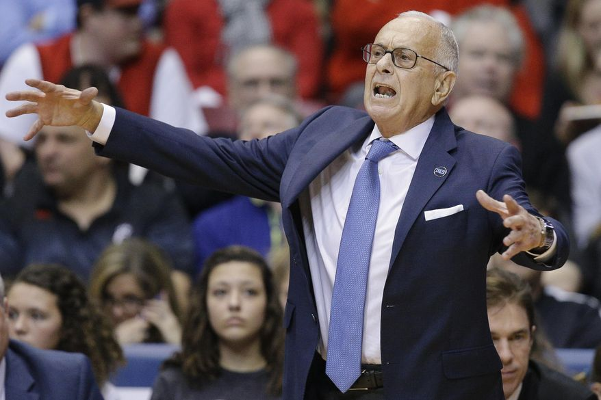 FILE - In this March 6, 2016, file photo, SMU head coach Larry Brown works the sideline during the first half of an NCAA college basketball game against Cincinnati, in Cincinnati. Larry Brown says he is resigning as SMU's basketball coach, ending a four-year run during which the Mustangs made the NCAA Tournament for the first time since 1993 and then were banned from postseason play last season. (AP Photo/John Minchillo, File)