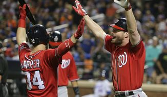 Washington Nationals' Daniel Murphy, right, is congratulated by Bryce Harper (34) after hitting a two-run home run against the New York Mets during the seventh inning of a baseball game, Saturday, July 9, 2016, in New York. (AP Photo/Julie Jacobson)