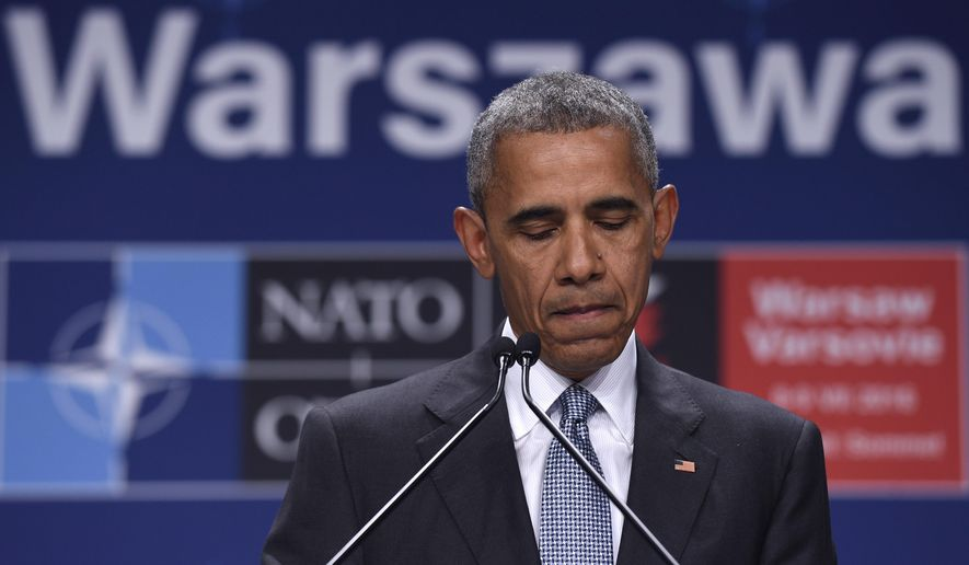 President Barack Obama pauses while speaking about the events in Dallas at the beginning of his news conference at PGE National Stadium in Warsaw, Poland, Saturday, July 9, 2016. Obama is in Warsaw attending the NATO Summit. (AP Photo/Susan Walsh)