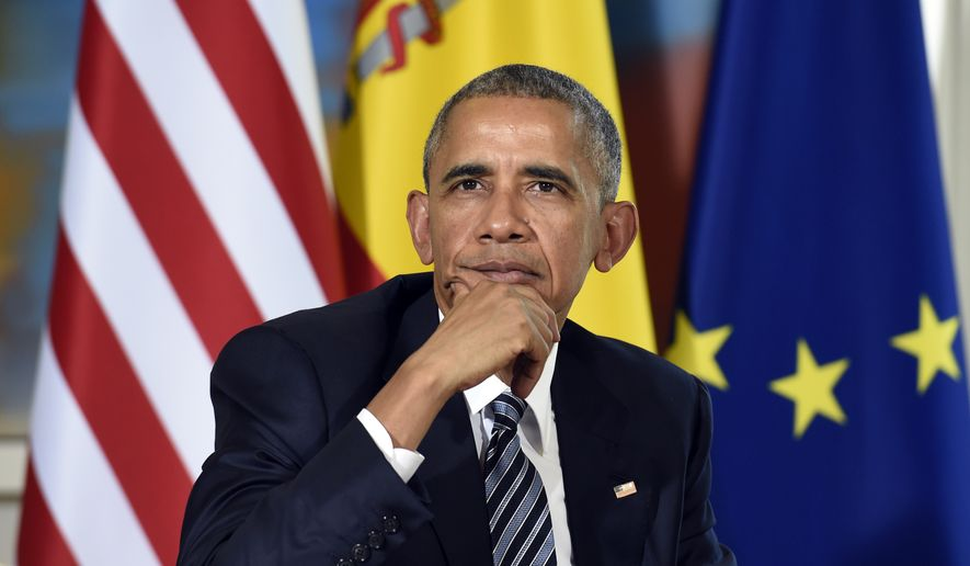 U.S President Barack Obama listens to a reporter's question during a media availability with Spain's acting Prime Minister Mariano Rajoy in Madrid, Spain, at the Palacio de la Moncloa, Sunday, July 10, 2016. (AP Photo/Susan Walsh)