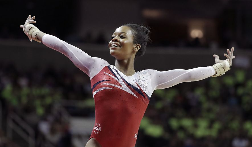 Gabrielle Douglas smiles after competing on the floor exercise during the women's U.S. Olympic gymnastics trials in San Jose, Calif., Sunday, July 10, 2016. (AP Photo/Gregory Bull)