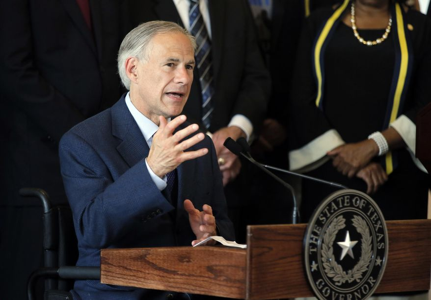"""FILE - In this Friday, July 8, 2016 file photo, Texas Gov. Greg Abbott, right, responds to questions about the police shootings during a news conference at City Hall in Dallas. Spokesman Matt Hirsch said Sunday that Abbott was in Jackson Hole, Wyo., Thursday when he was scalded in an accident involving hot water. He sustained """"extensive second- and third-degree burns"""" on both legs below the knees and on both feet and could miss next week's Republican National Convention. Abbott held the press conference in Dallas on Friday, but didn't disclose being burned. (AP Photo/Tony Gutierrez, File)"""