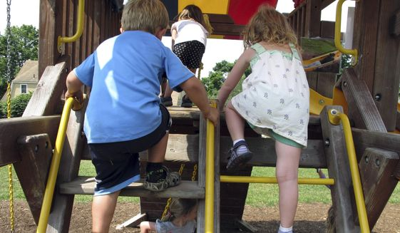 Children climb on playground equipment in Vermont, July 27, 2016. (AP Photo/Lisa Rathke) ** FILE **