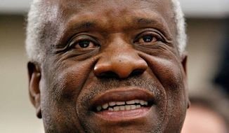 Justice Clarence Thomas       Associated Press photo