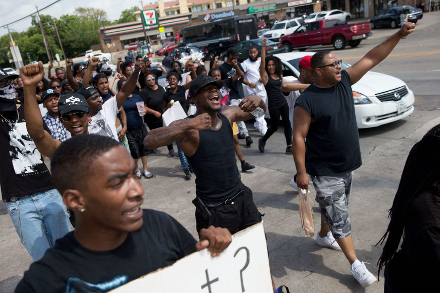 """Even as protesters continue to march in Dallas, Black Lives Matter leaders have denounced the bloodshed there Thursday. They said in a post after the massacre of five police officers and the woundings of others that """"[b]lack activists have raised the call for an end to violence, not an escalation of it."""" (Associated Press)"""