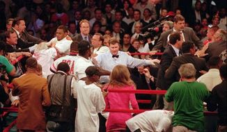 The fight between Riddick Bowe and Andrew Golota led to dozens of other fights in the ring and stands. / AP photo