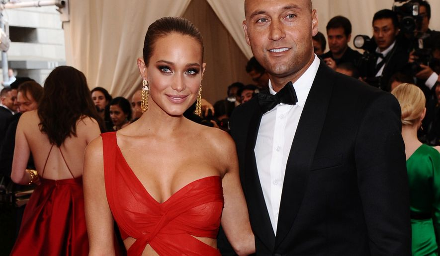 """FILE - In this May 4, 2015, file photo, Derek Jeter, right, and Hannah Davis arrive at The Metropolitan Museum of Art's Costume Institute benefit gala celebrating """"China: Through the Looking Glass"""" in New York. Derek Jeter has reportedly married his longtime girlfriend, Sports Illustrated swimsuit model Hannah Davis. TMZ and the New York Post have published photos of the weekend ceremony at the Meadowood resort in California's Napa Valley.  (Photo by Charles Sykes/Invision/AP, File)"""