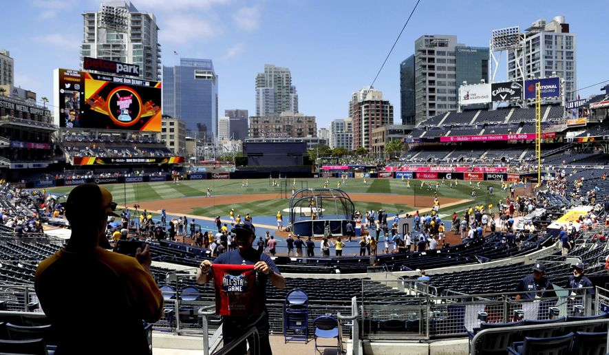 Colin Cann has his picture taken by his son, Alex Cann, prior to the MLB All-Star baseball Home Run Derby, Monday, July 11, 2016, in San Diego. (AP Photo/Jae Hong)
