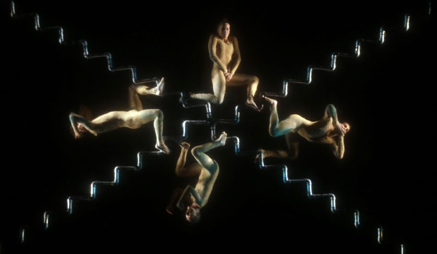 "In this Thursday, July 7, 2016 photo, members of the Italian Nogravity Dance Company perform ""From hell to paradise, Trips of the soul,"" at the Julio Mario Santo Domingo Theater in Bogota, Colombia. The dancers are suspended form the air with cables and ropes and perform behind a semi-transparent screen. (AP Photo/Fernando Vergara)"