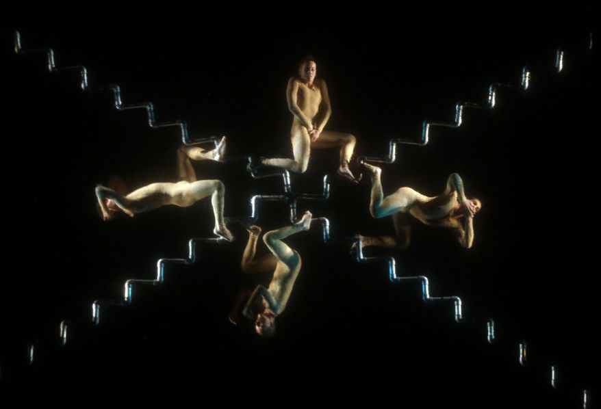 """In this Thursday, July 7, 2016 photo, members of the Italian Nogravity Dance Company perform """"From hell to paradise, Trips of the soul,"""" at the Julio Mario Santo Domingo Theater in Bogota, Colombia. The dancers are suspended form the air with cables and ropes and perform behind a semi-transparent screen. (AP Photo/Fernando Vergara)"""