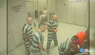 A group of Texas inmates sprang into action after their lone guard suffered an apparent heart attack and lost consciousness. (WFAA via USA Today)
