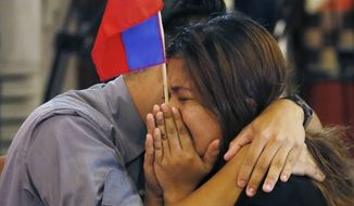 Filipinos were emotional after the Hague-based U.N. international arbitration tribunal ruled Tuesday in favor of the Philippines in its case against China on the dispute in South China Sea. (Associated Press)