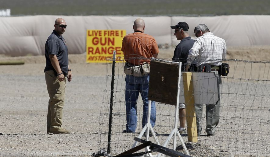 FILE - This Aug. 27, 2014 file photo shows people seen at the Last Stop outdoor shooting range in White Hills, Ariz. The girl who accidentally killed the shooting range instructor, Charles Vacca, in northern Arizona had said immediately after the shooting that she felt the gun was too much for her and had hurt her shoulder, according to police reports released Tuesday, Sept. 2, 2014. (AP Photo/John Locher, File)