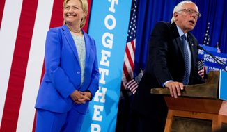 Democratic presidential candidate Hillary Clinton listen as Sen. Bernie Sanders, I-Vt. speaks during a rally in Portsmouth, N.H., Tuesday, July 12, 2016, where Sanders endorsed Clinton for president. (AP Photo/Andrew Harnik)
