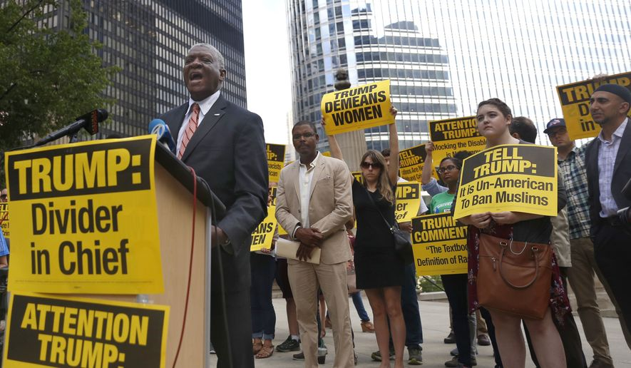 William McNary, left, with Citizen Action Illinois, speaks against Republican presidential candidate Donald Trump, next to the Chicago River across from the Trump International Hotel and Tower in Chicago, Tuesday, July 12, 2016. (AP Photo/Tae-Gyun Kim)