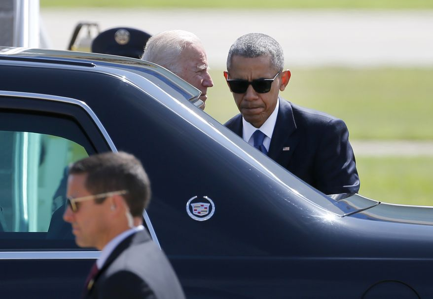 President Barack Obama and Vice President Joe Biden talk outside the presidents limousine before taking off from Love Field Airport, Tuesday, July 12, 2016, in Dallas. Obama and Biden attended the memorial service for the five fallen Dallas police officers. (AP Photo/Tony Gutierrez)