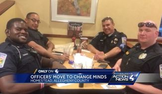 Pennsylvania police officers picked up the tab Saturday for a couple of diners who reportedly refused to sit next to them at an Eat N' Park restaurant in Homestead. (WTAE)