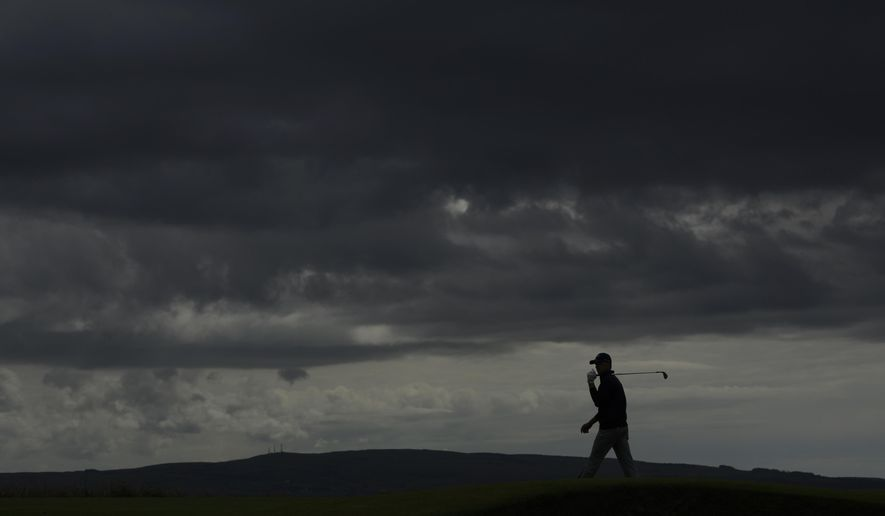 Jordan Spieth of the US, walks on the 5th green during a practice round ahead of the British Open Golf Championship at the Royal Troon Golf Club in Troon, Scotland, Tuesday, July 12, 2016.  (AP Photo/Matt Dunham)