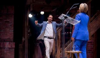 Hamilton creator Lin-Manuel Miranda reaches to hug Democratic presidential candidate Hillary Clinton after she speaks briefly on stage following a special performance of the broadway show Hamilton in Support of the Hillary Victory Fund, Thursday, July 12, 2016, at Richards Rogers Theater in New York. (AP Photo/Andrew Harnik)