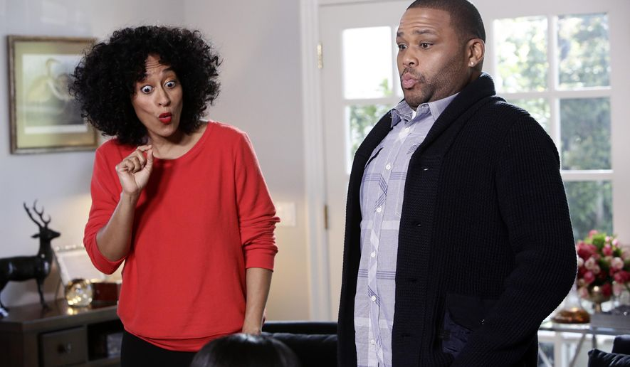 "In this image released by ABC, Tracee Ellis Ross, left, and Anthony Anderson appear in a scene from ""Black-ish."" The hit sitcom which has masterfully teased insight and humor out of troubling issues including police brutality and the N-word, is poised to have a breakout showing for its sophomore season. (Nicole Wilder/ABC via AP)"