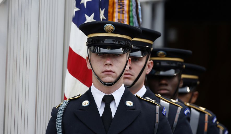 A U.S. Army color guard waits to present the colors before a baseball game between the Washington Nationals and the Milwaukee Brewers at Nationals Park, Monday, July 4, 2016, in Washington. (AP Photo/Alex Brandon)