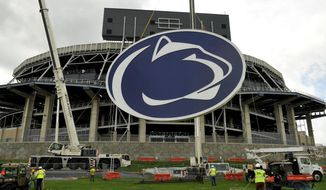 "FILE - In this May 15, 2014 file photo, a logo is lifted by crane to the back of a scoreboard at Penn State's Beaver Stadium in State College, Pa.   Judge Gary Glazer is expected to release records Tuesday, July 12, 2016, that also may contain details about claims Penn State assistant coaches saw ""inappropriate contact"" and ""sexual contact"" between Sandusky and a child in 1987 and 1988.(AP Photo/Centre Daily Times, Nabil K. Mark) MANDATORY CREDIT  MAGS OUT"