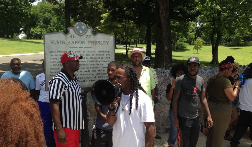 Memphis police say a small group of people associated with the Black Lives Matter movement have gathered outside Elvis Presley's home, and two people have been detained for blocking the street. Police spokeswoman Karen Rudolph said about 30 protesters are at Graceland. She didn't know if the two who were detained Tuesday, July, 12, 2016, were arrested or charged. (AP Photo/Adrian Sainz)