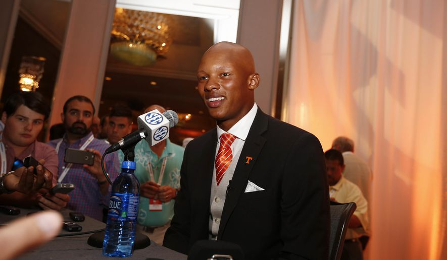 Tennessee quarterback Joshua Dobbs speaks to the media at the Southeastern Conference NCAA college football media days, Tuesday, July 12, 2016, in Hoover, Ala. (AP Photo/Brynn Anderson)