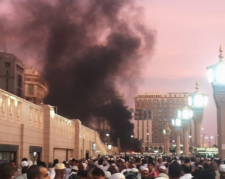 A suicide bomber struck a parking lot near the Prophet's Mosque in Medina in one of three terrorist attacks in Saudi Arabia on July 4. The blast set several cars on fire, killed four security officers and injured five others. (Associated Press)