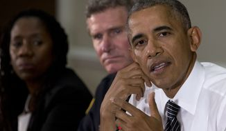 From left: Sherillyn Ifill, president and director-counsel of the NAACP Legal Defense and Educational Fund, and Terry Cunningham, president of the International Association of Chiefs of Police, look to President Barack Obama as he speaks to media at the bottom of a meeting at the Eisenhower Executive Office Building on the White House complex in Washington on July 13, 2016, about community policing and criminal justice with a group made of activists, civil rights, faith, law enforcement and elected leaders. (Associated Press) **FILE**