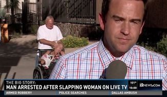 Randall Burgess, 60, was arrested after he was seen slapping a woman in a wheelchair in the background a live TV news broadcast. (KPNX)
