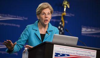 Sen. Elizabeth Warren, D-Mass. peaks to the Center of American Progress Action Fund, Wednesday, July 13, 2016, in Washington. (AP Photo/Evan Vucci)