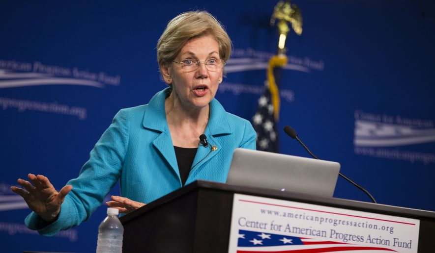 Sen. Elizabeth Warren, D-Mass. peaks to the Center of American Progress Action Fund, Wednesday, July 13, 2016, in Washington. (AP Photo/Evan Vucci)