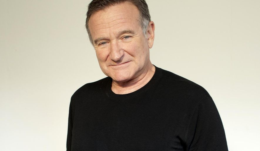 "FILE - In this Nov. 5, 2011 file photo, actor Robin Williams poses for a portrait during the ""Happy Feet"" press junket in Beverly Hills, Calif. Arthur Grace, a photographer and friend of the late Robin Williams, is publishing a book with 190 of his photographs of the late actor-comedian. It will be released next month. (Dan Steinberg/Invision/AP, File)"