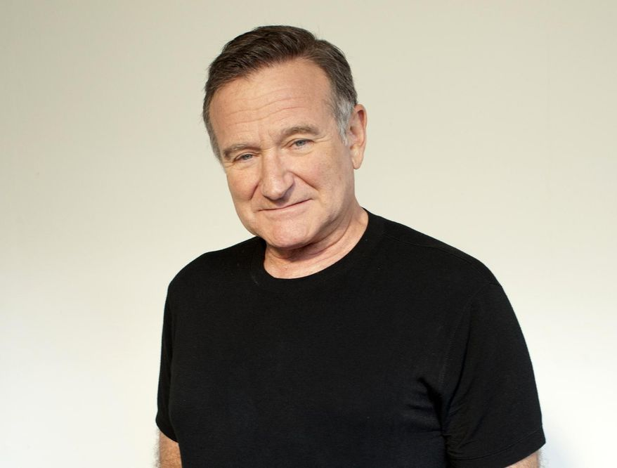 """FILE - In this Nov. 5, 2011 file photo, actor Robin Williams poses for a portrait during the """"Happy Feet"""" press junket in Beverly Hills, Calif. Arthur Grace, a photographer and friend of the late Robin Williams, is publishing a book with 190 of his photographs of the late actor-comedian. It will be released next month. (Dan Steinberg/Invision/AP, File)"""