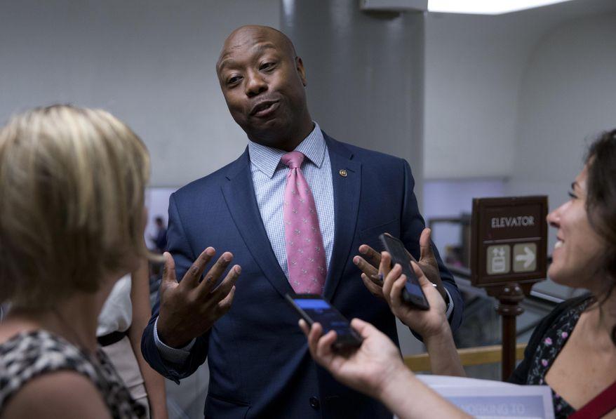 In this June 21, 2016, file photo, Sen. Tim Scott, R-S.C., talks with reporters on Capitol Hill in Washington. (AP Photo/Alex Brandon, File)
