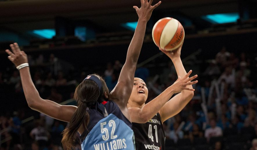 Atlanta Dream's Elizabeth Williams (52) blocks a shot by New York Liberty's Kiah Stokes (41) in the first period of a WNBA basketball game, Wednesday, July 13, 2016 in New York. (AP Photo/Mark Lennihan)