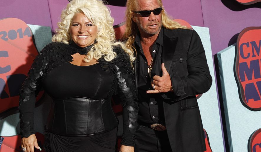 "FILE - In this June 4, 2014 file photo, Beth Chapman, left, and Duane Chapman arrive at the CMT Music Awards at Bridgestone Arena, in Nashville, Tenn. Hawaii's attorney general says ""Dog the Bounty Hunter"" reality TV star Duane ""Dog"" Chapman's bail bonds business owes the state $35,000. Attorney General Doug Chin says Wednesday, July 13, 2016, his office is suing Da Kine Bail Bonds for money it promised to pay when the company's clients skipped court. (Photo by Wade Payne/Invision/AP, File)"