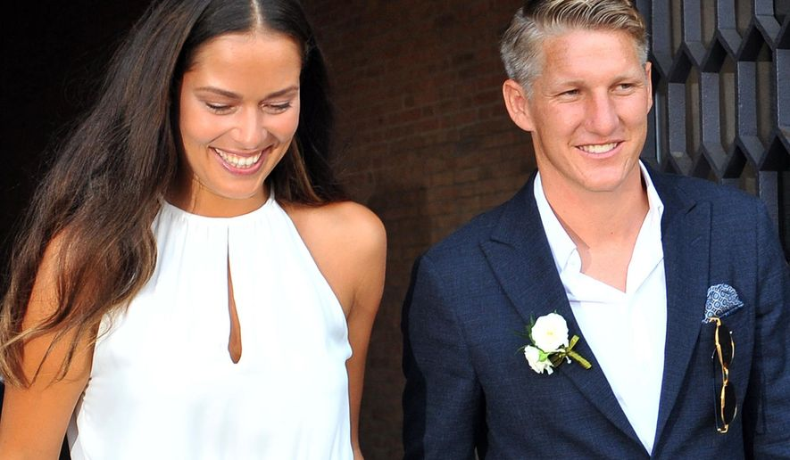 Tennis player Ana Ivanovic and Germany soccer player Bastian Schweinsteiger smile during their wedding, in Venice, Italy, Tuesday, July 12, 2016. (AP Photo/Luigi Costantini)