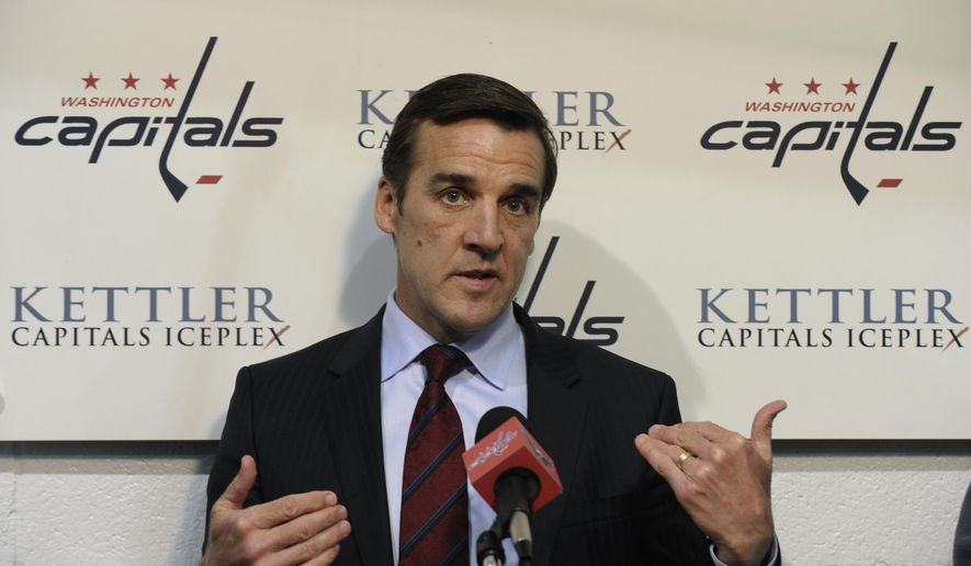 FILE - In this May 15, 2013, file photo, Washington Capitals general manager George McPhee talks with reporters at the Kettler Iceplex in Arlington, Va. A person with direct knowledge of the decision says McPhee has been hired as general manager of the NHL's expansion Las Vegas franchise. The person spoke on condition of anonymity because owner Bill Foley's announcement was set for Wednesday afternoon, July 13, 2016. McPhee most recently served as special advisor to New York Islanders GM Garth Snow. Before that he spent 16 seasons as GM of the Washington Capitals.  (AP Photo/Susan Walsh, FIle) **FILE**
