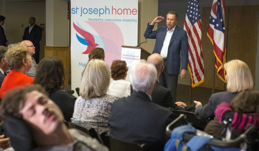 "Ohio Gov. John Kasich speaks before signing legislation into law at St. Joseph Home, which serves children and adults with severe developmental disabilities, Wednesday, July 13, 2016, in Cincinnati. One bill strikes the term ""mental retardation"" from the Ohio Revised Code and replaces such references in law with the term ""intellectual disability."" The other bill is part of the governor's mid-biennium budget review and makes certain changes to programs administered by the state's Department of Developmental Disabilities. (AP Photo/John Minchillo)"
