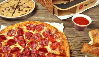 Pizza Hut pizza, breadsticks, and cookies, as depicted in a July 2016 photo accessed from the chain's official Facebook page on July 13, 2016. (https://www.facebook.com/pizzahutus/photos/a.423403992414.204101.6053772414/10154057115487415/?type=3&theater)
