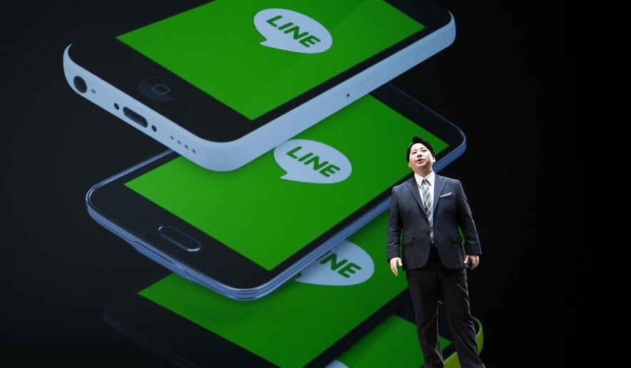 FILE - In this March 24, 2016, file photo, Line Corp. Chief Strategy and Marketing Officer Jun Masuda speaks during a news conference of Line Conference Tokyo 2016 in Urayasu, near Tokyo. Line, the Japanese messaging app that counts more users in the country than Facebook or Twitter, is set to begin trading its stock on the New York Stock Exchange on Thursday, July 14 and in Tokyo on Friday, July 15. (AP Photo/Shizuo Kambayashi, File)