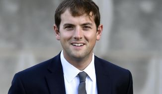 "In this Oct. 29, 2014 photo, Luke Russert arrives for the funeral service for Ben Bradlee at the National Cathedral in Washington. Russert, son of the late ""Meet the Press"" moderator Tim Russert, says that he's leaving NBC News to take some time away from political reporting. His announcement Wednesday came on the eve of the national political conventions. (AP Photo/Susan Walsh, File) **FILE**"