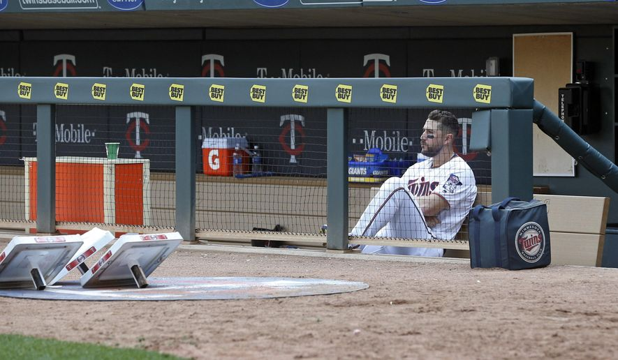 FILE - In this April 14, 2016 file photo, Minnesota Twins' Trevor Plouffe sits alone in the dugout after the winless Twins loss to the Chicago White Sox in a baseball game in Minneapolis. During the 2000s, as Minnesota piled up division titles in the dingy Metrodome, the organizations ability to produce fundamentally solid players and competitive teams without expensive power hitters or starting pitchers became known around baseball as the Twins Way. They're the wayward Twins these days, mired in a miserable season that's put them on pace to top 100 losses. (AP Photo/Jim Mone,File)