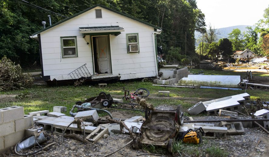 In a Friday, July 1, 2016 photo, the Phillips family home sits several feet away from its broken foundation at the end of Mill Hill Drive in White Sulphur Springs, WV. The family is still searching for 14-year-old Mykala Phillips. Mykala went missing as she was trying to escape from the house with family members during the flood on June 23. Phillips is the only person still unaccounted for from the floods that killed 22 others in West Virginia. (Sam Owens/Charleston Gazette-Mail via AP)